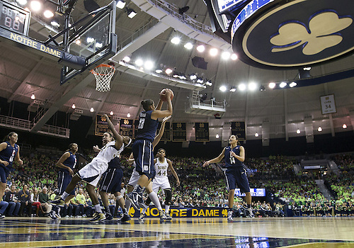 March 04, 2013:  A general view as Connecticut forward Kaleena Mosqueda-Lewis (23) grabs the rebound during NCAA Basketball game action between the Notre Dame Fighting Irish and the Connecticut Huskies at Purcell Pavilion at the Joyce Center in South Bend, Indiana.  Notre Dame defeated Connecticut 96-87 in triple overtime.