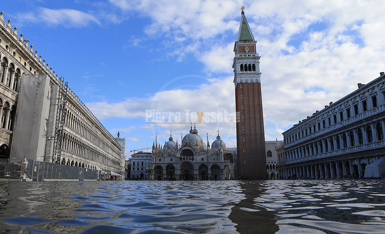 Venice underwater as exceptional tide sweeps through canal city. St. Mark's Square on November 14, 2019 in Venice, Italy. Much of Venice was left under water after the highest tide in 50 years ripped through the historic Italian city, beaching gondolas, trashing hotels and sending tourists fleeing through rapidly rising waters.