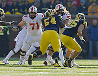 Ohio State Buckeyes offensive linesman Corey Linsley (71) and Ohio State Buckeyes offensive linesman Andrew Norwell (78) against Michigan Wolverines during their college football game at Michigan Stadium in Ann Arbor, Michigan on November 30, 2013.  (Dispatch photo by Kyle Robertson)