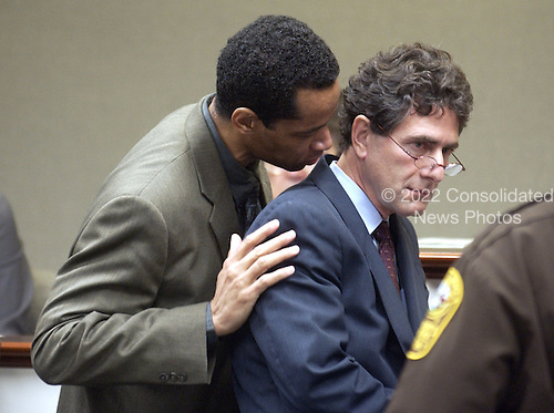 Sniper suspect John Allen Muhammad, left, talks with his attorney Jonathan Shapiro, right, during a bench conference at the Virginia Beach Circuit Court in Virginia Beach, Virginia on November 3, 2003.<br /> Credit: Lawrence Jackson - Pool via CNP