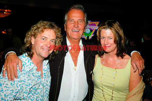 Pat Boone (c) with Jack Blades of Nightranger and his wife Mollie..at the 9th Annual Alice Cooper Celebrity Golf Tournament in Scottsdale, Arizona, May 1st 2005.  Photo by Chris Walter/Photofeatures.