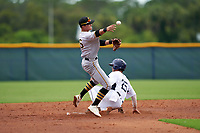 GCL Pirates second baseman Jase Bowen (26) throws to first base as Duke Kinamon (25) slides in during a Gulf Coast League game against the GCL Rays on August 7, 2019 at Charlotte Sports Park in Port Charlotte, Florida.  GCL Rays defeated the GCL Pirates 4-1 in the first game of a doubleheader.  (Mike Janes/Four Seam Images)
