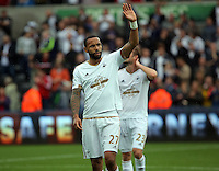 Pictured: Kyle Bartley of Swansea thanks home supporters after the end of the game Sunday 30 August 2015<br />
