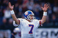 OAKLAND, CA - Quarterback John Elway of the Denver Broncos in action signaling for a touchdown during a game against the Oakland Raiders at the Oakland Coliseum in Oakland, California in 1995. Photo by Brad Mangin