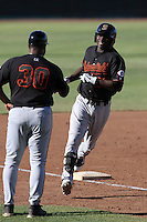 Bakersfield Blaze shortstop Didi Gregorius #21 is greeted by manager Ken Griffey,sr. #30 after hitting a home run during a game against the High Desert Mavericks at Mavericks Stadium on July 17, 2011 in Adelanto,California. Bakersfield defeated High Desert 11-10.(Larry Goren/Four Seam Images)