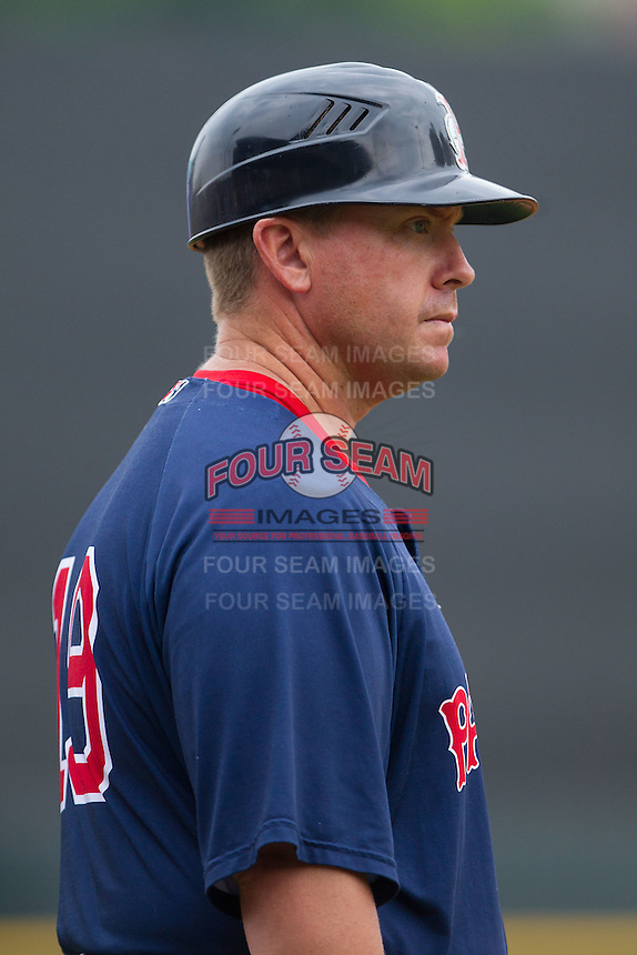 Pawtucket Red Sox manager Kevin Boles (19) coaches third base during the game against the Charlotte Knights at BB&T Ballpark on August 8, 2014 in Charlotte, North Carolina.  The Red Sox defeated the Knights  11-8.  (Brian Westerholt/Four Seam Images)