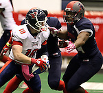SIOUX FALLS, SD - MAY 16:  Cody Kirby #18 form the Bemidji Axemen looks to escape the grasp of Eze Obiora #44 from the Sioux Falls Storm in the first half of their game Saturday night at the Sioux Falls Arena. (Photo by Dave Eggen/Inertia)