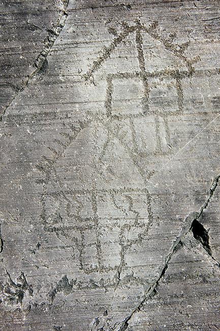 Petroglyph, rock carving, of two houses on stilts. Carved by the ancient Camunni people in the iron age between 1000-1200 BC. Rock no 6, Foppi di Nadro, Riserva Naturale Incisioni Rupestri di Ceto, Cimbergo e Paspardo, Capo di Ponti, Valcamonica (Val Camonica), Lombardy plain, Italy