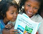Girls read a RARE conservation booklet, Papagaran island, Komodo National Park
