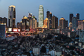 An overview of Chongqing city, one of the fastest-growing and biggest cities on earth, with a population of 29 million. <br /> <br /> The slum area under the high-rises was marked for demolition. By 2016, the area has already been entirely rebuilt. <br /> <br /> Situated in southwestern China, away from the coast, it is the engine of China's inland economic development. <br /> <br /> China is pushing ahead with a dramatic, history-making plan to move 100 million rural residents into towns and cities over the next six years &mdash; but without a clear idea of how to pay for the gargantuan undertaking or whether the farmers involved want to move.<br /> <br /> Moving farmers to urban areas is touted as a way of changing China&rsquo;s economic structure, with growth based on domestic demand for products instead of exporting them. In theory, new urbanites mean vast new opportunities for construction firms, public transportation, utilities and appliance makers, and a break from the cycle of farmers consuming only what they produce.<br /> <br /> Urbanization has already proven to be one of the most wrenching changes in China&rsquo;s 35 years of economic reforms. Land disputes rising from urbanization account for tens of thousands of protests each year.