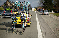 Sep Vanmarcke (BEL/LottoNL-Jumbo) is the very last rider as he rejoins the race after a mechanical and can start chasing to catch the peloton again. Teammate Rick Flens (NLD/LottoNL-Jumbo) gets a pad on the back for waiting for his team leader to help him get back to the peloton.<br /> <br /> 58th E3 Harelbeke 2015