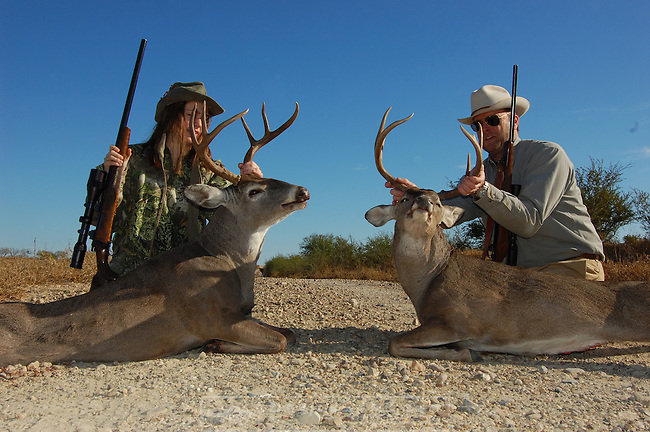 DEER HUNTING..Webb County Texas with Kelly Jordon Bass Fishing Pro.Lili and David Sams with harvested bucks hunting from tripod stands glassing Nikon binos.