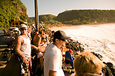 USA, Hawaii, Oahu, large crowd of people watch the Eddie Aikau surfing competition at Waimea Bay