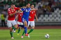 Israel's Omer Damari (C) fights for the ball with Hungary's Adam Pinter (L) and Hungary's Adam Gyurcso (R) during a friendly football match Hungary playing against Israel in Budapest, Hungary on August 15, 2012. ATTILA VOLGYI