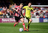 Lincoln City's Harry Anderson vies for possession with Cheltenham Town's Jordan Tillson<br /> <br /> Photographer Chris Vaughan/CameraSport<br /> <br /> The EFL Sky Bet League Two - Lincoln City v Cheltenham Town - Saturday 13th April 2019 - Sincil Bank - Lincoln<br /> <br /> World Copyright © 2019 CameraSport. All rights reserved. 43 Linden Ave. Countesthorpe. Leicester. England. LE8 5PG - Tel: +44 (0) 116 277 4147 - admin@camerasport.com - www.camerasport.com