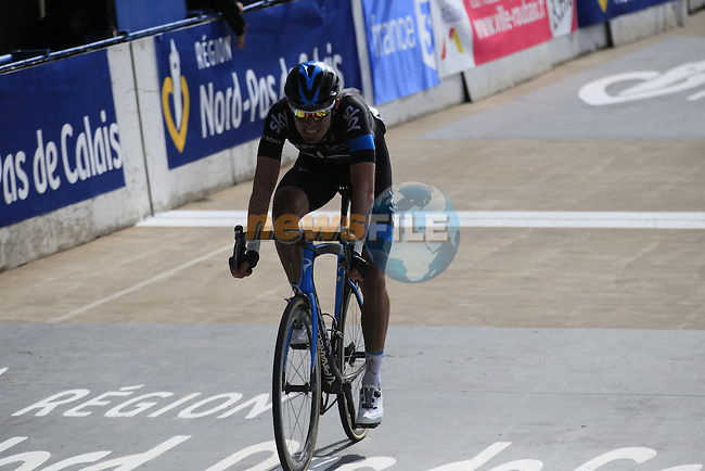Luke Rowe (GBR) Team Sky crosses the line in 8th place in the famous Roubaix Velodrome at the end of the 113th edition of the Paris-Roubaix 2015 cycle race held over the cobbled roads of Northern France. 12th April 2015.<br /> Photo: Eoin Clarke www.newsfile.ie