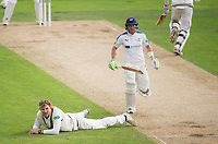 Picture by Allan McKenzie/SWpix.com - 06/09/2017 - Cricket - Specsavers County Championship - Yorkshire County Cricket Club v Middlesex County Cricket Club - Headingley Cricket Ground, Leeds, England - Middlesex's Ollie Rayner is flat out as Yorkshire's Andrew Hodd goes to his half-century.