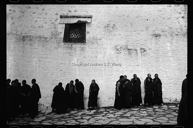 Tibetan monks gather outside the main hall of the Sera Monastery in Lhasa, Tibet,  September 2016.