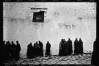 Tibetan monks gather outside the main hall of the Sera Monastery in Lhasa, Tibet,  September 2016.
