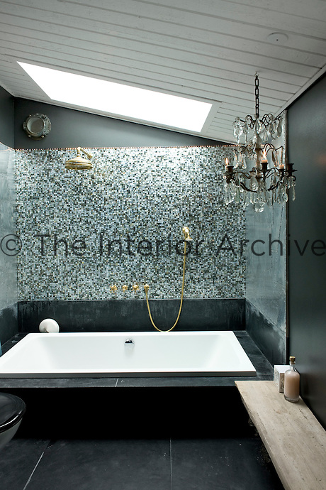 The creation of this bathroom is based on a dream of being surrounded by a shell, the walls are covered in mother-of-pearl mosaic tiles