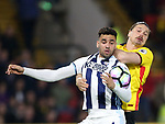 Watford's Sebastian Prodl tussles with WBA's Hal Robson-Kanu during the Premier League match at Vicarage Road Stadium, London. Picture date: April 4th, 2017. Pic credit should read: David Klein/Sportimage