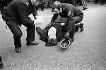 Willisden, London. 1977<br /> PC Trevor Wilson lies in a pool of his own blood during violent clashes between demonstrators and police outside the Grunwick film processing plant.   <br /> <br /> <br /> <br /> ----