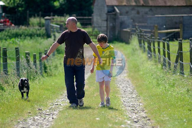 120606 - Organic farmer John McDonnell and his son Finn photographed at his farm (Shalvanstown) near Slane county Meath..Photo:Barry Cronin/Newsfile.