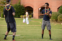 NWA Democrat-Gazette/BEN GOFF @NWABENGOFF<br /> Daniel McDonald (left) of Bentonville and fellow Northwest Arkansas Community College student Troy Charlton of Rogers hula hoop on Thursday Sept. 24, 2015 during the annual Northwest Arkansas Community College Student Ambassador and Activities Board Welcome Back Luau at the school's Bentonville campus.