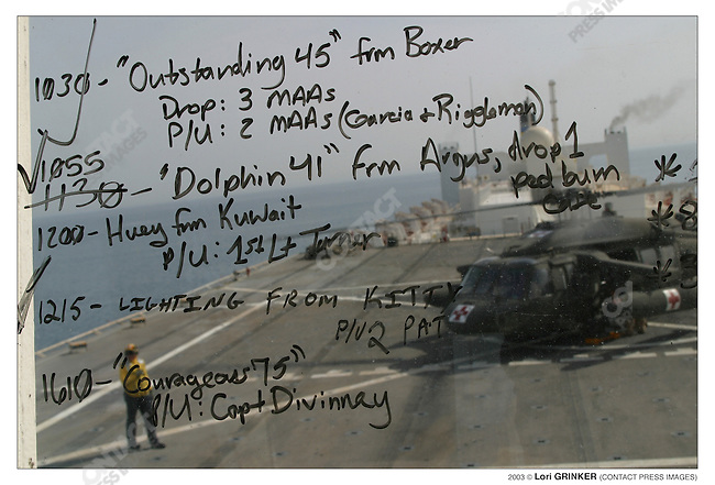 Window of the Control tower with the list of helicopters coming in and going out on this day. USNS COMFORT Naval hospital ship in the Persian Gulf.
