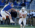 BROOKINGS, SD - NOVEMBER 12:  Cole Langer #54 from South Dakota State University teams to grab Chris Streveler #15 from the University of South Dakota in the first half at the Dana J. Dykhouse Stadium November 12, 2016 in Brookings, South Dakota. (Photo by Dave Eggen/Inertia)