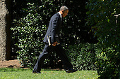 United States President Barack Obama walks to the Oval Office after returning from a visit to the State Department, at the White House in Washington DC, USA, 12 September 2012. Gunmen attacked the US consulate in Benghazi, killing US ambassador to Libya, Christopher Stevens, late 11 September 2012, while another assault took place on the US embassy in Cairo..Credit: Michael Reynolds / Pool via CNP