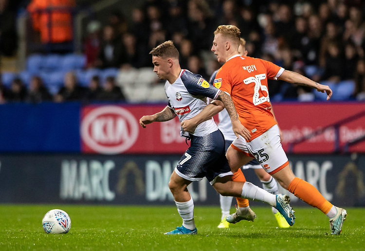 Bolton Wanderers' Thibaud Verlinden (left) breaks away from Blackpool's Callum Guy <br /> <br /> Photographer Andrew Kearns/CameraSport<br /> <br /> The EFL Sky Bet League One - Bolton Wanderers v Blackpool - Monday 7th October 2019 - University of Bolton Stadium - Bolton<br /> <br /> World Copyright © 2019 CameraSport. All rights reserved. 43 Linden Ave. Countesthorpe. Leicester. England. LE8 5PG - Tel: +44 (0) 116 277 4147 - admin@camerasport.com - www.camerasport.com