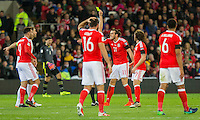 Gareth Bale of Wales receives a yellow card during the FIFA World Cup Qualifying match between Wales and Serbia at the Cardiff City Stadium, Cardiff, Wales on 12 November 2016. Photo by Mark  Hawkins.