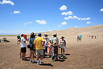 Group of people on a guided walk at Great Sand Dunes National Park and Preserve, Colorado, USA