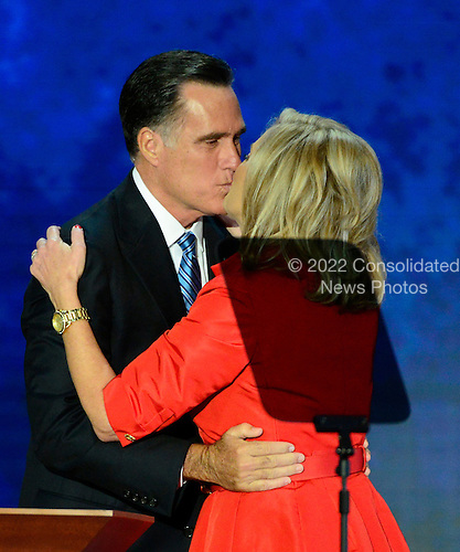 GOP nominee Mitt Romney kisses his wife, Ann, after she made remarks at the 2012 Republican National Convention in Tampa Bay, Florida on Tuesday, August 28, 2012.  .Credit: Ron Sachs / CNP.(RESTRICTION: NO New York or New Jersey Newspapers or newspapers within a 75 mile radius of New York City)