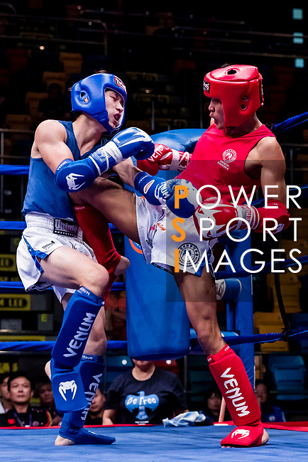Amarjargal Nyamlkhagva (Red) of Mongolia fights against Ieong Pan (Blue) of Macau in the male muay 51KG division weight bout during the East Asian Muaythai Championships 2017 at the Queen Elizabeth Stadium on 11 August 2017, in Hong Kong, China. Photo by Yu Chun Christopher Wong / Power Sport Images