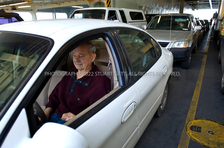 4/6/2007--Clinton, WA, USA..89 year old Jim Welden from Freeland on Whidbey Island, Washington, sits in his car on the ferry from Clinton to Mukilteo. State officials are pushing for a new law that would fine line jumpers at the ferry terminals as more and more tourists and commuters travel the route...Photograph ©2007 Stuart Isett.All rights reserved