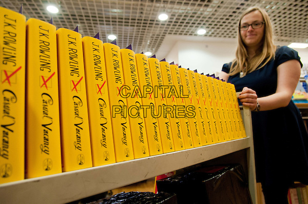 JK Rowling's first novel for adults, 'The Casual Vacancy', is delivered to Foyles bookstore on the day of publication. Foyles, St Pancras Station, London, England..September 27th, 2012.half length trolley book yellow spine hardback gv general view .CAP/BF.©Bob Fidgeon/Capital Pictures.