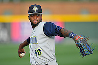 Center fielder Ivan Wilson (18) of the Columbia Fireflies warms up before a game against the Greenville Drive on Friday, April 22, 2016, at Fluor Field at the West End in Greenville, South Carolina. Columbia won, 5-3. (Tom Priddy/Four Seam Images)