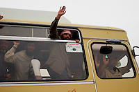 former Iraqi prisoners just released salut the crowd and relatives while still on the bus autside the prison of Abu Graib in BAghdad on MAy 28 2004. in the same day 400 prisoners will be relased.