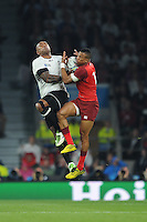 Nemani Nadolo of Fiji and Anthony Watson of England compete for the ball during Match 1 of the Rugby World Cup 2015 between England and Fiji - 18/09/2015 - Twickenham Stadium, London <br /> Mandatory Credit: Rob Munro/Stewart Communications