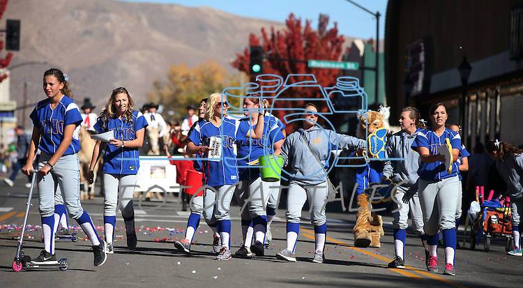 The Western Nevada College Wildcats softball team walks in the 75th annual Nevada Day parade in Carson City, Nev., on Saturday, Oct. 26, 2013.<br /> Photo by Cathleen Allison