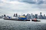CANADA, Vancouver, British Columbia, a tugboat pushes a barge in the Vancouver Harbor