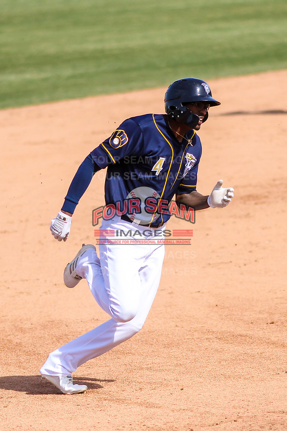 Wisconsin Timber Rattlers outfielder Je'Von Ward (4) rounds third base during a Midwest League game against the Burlington Bees on April 28, 2019 at Fox Cities Stadium in Appleton, Wisconsin. Wisconsin defeated Burlington 5-4. (Brad Krause/Four Seam Images)