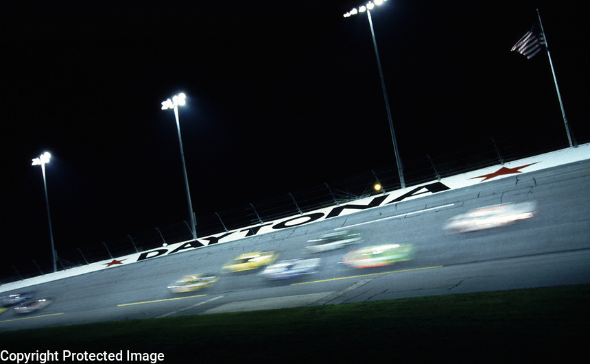 Cars streak through the fourth turn at Daytona during the Pepsi 400 in July 2000. (Photo by Brian Cleary)