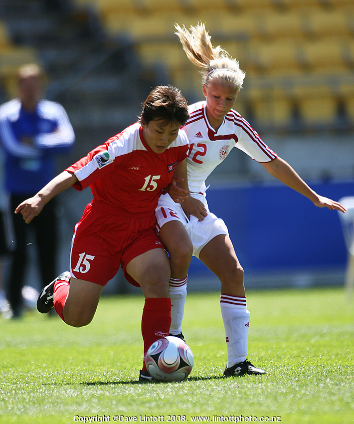 Un Ae Ri and Pernille Harder compete for the ball during the FIFA Women's Under-17 World Cup pool match between Denmark and Korea DPR at Westpac Stadium, Wellington, New Zealand on Saturday, 8 November 2008. Photo: Dave Lintott / lintottphoto.co.nz