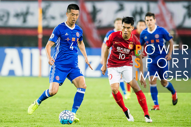 Bai He (l) of Eastern SC fights for the ball with Zheng Zhi of Guangzhou Evergrande FC during their AFC Champions League 2017 Match Day 1 Group G match between Guangzhou Evergrande FC (CHN) and Eastern SC (HKG) at the Tianhe Stadium on 22 February 2017 in Guangzhou, China. Photo by Victor Fraile / Power Sport Images