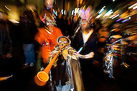 New Year's Eve revelers welcome in 2010 in downtown Charlotte NC during First Night Charlotte 2010. The family-friendly public event (no alcohol allowed) is an annual cultural New Year's Eve celebration held in downtown / uptown / Charlotte center city. Charlotte First Night - An Imagination Celebration brought together artists, musicians, dancers and more from across the country. The New Year's event is organized by Charlotte Center City Partners, which facilitates and promotes the economic and cultural development of this North Carolina urban core.