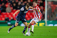 11th January 2020; Bet365 Stadium, Stoke, Staffordshire, England; English Championship Football, Stoke City versus Milwall FC; Jayson Molumby of Millwall is tackled by Nick Powell of Stoke City - Strictly Editorial Use Only. No use with unauthorized audio, video, data, fixture lists, club/league logos or 'live' services. Online in-match use limited to 120 images, no video emulation. No use in betting, games or single club/league/player publications