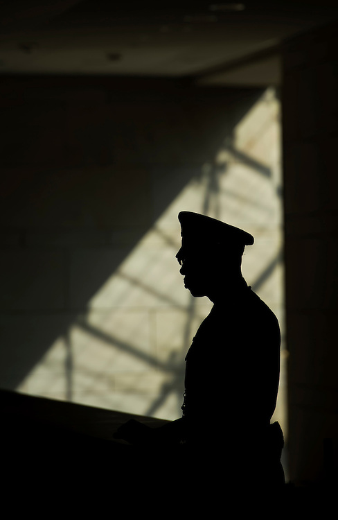 UNITED STATES - OCTOBER 01: A Capitol Police officer stand guard in the Capitol Visitor Center. (Photo By Tom Williams/CQ Roll Call)